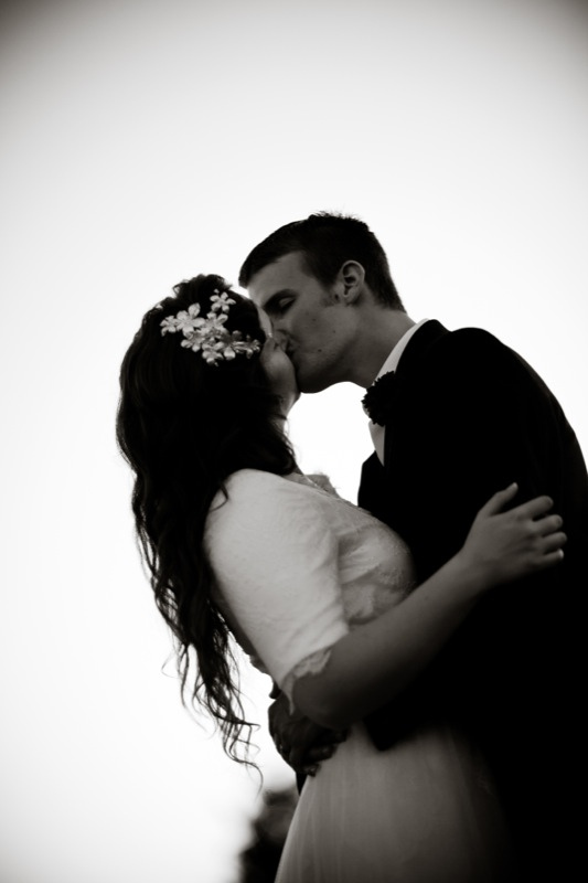 Black and white of photos of married couple kissing