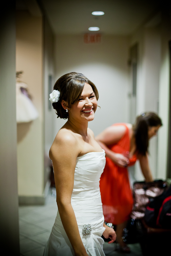 Bride smiling while getting ready with the bridesmaids