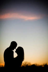 at sunset and about to kiss