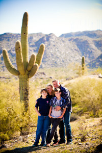 the family with cacti in the background