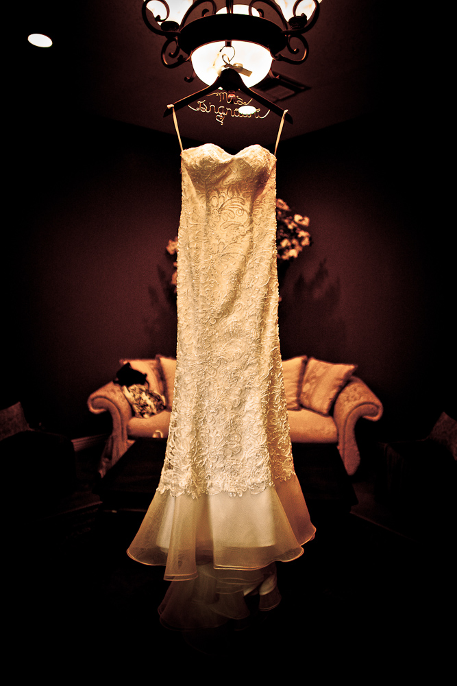 The wedding dress hanging in the bride