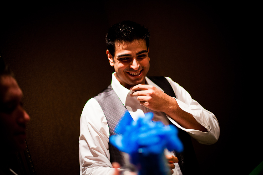 the groom laughing while giving gifts