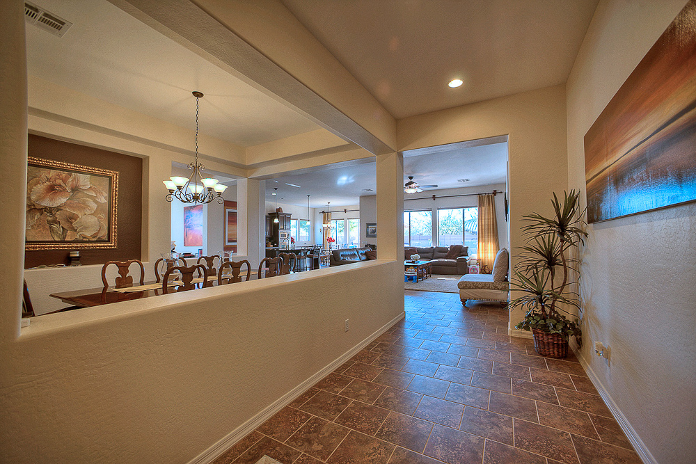 front door entry to dining room and open concept living area